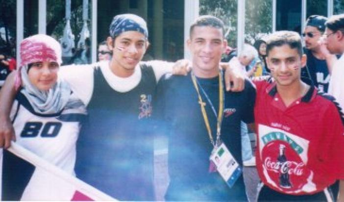 Adel, Omar, and Assmaah Helal with an Egyptian Olympic Boxer